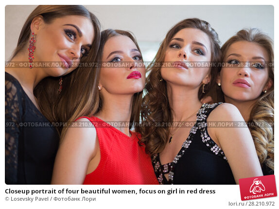 Купить «Closeup portrait of four beautiful women, focus on girl in red dress», фото № 28210972, снято 22 апреля 2015 г. (c) Losevsky Pavel / Фотобанк Лори