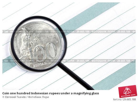 Купить «Coin one hundred Indonesian rupees under a magnifying glass», фото № 29665188, снято 22 января 2019 г. (c) Евгений Ткачёв / Фотобанк Лори