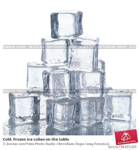 Cold. Frozen ice cubes on the table. Стоковое фото, фотограф Zoonar.com/Yeko Photo Studio / easy Fotostock / Фотобанк Лори