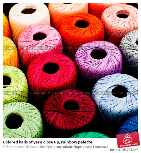 Colored balls of yarn close up, rainbow palette. Стоковое фото, фотограф Zoonar.com/Oksana Shufrych / easy Fotostock / Фотобанк Лори