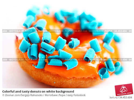 Colorful and tasty donuts on white background. Стоковое фото, фотограф Zoonar.com/Sergejs Rahunoks / easy Fotostock / Фотобанк Лори