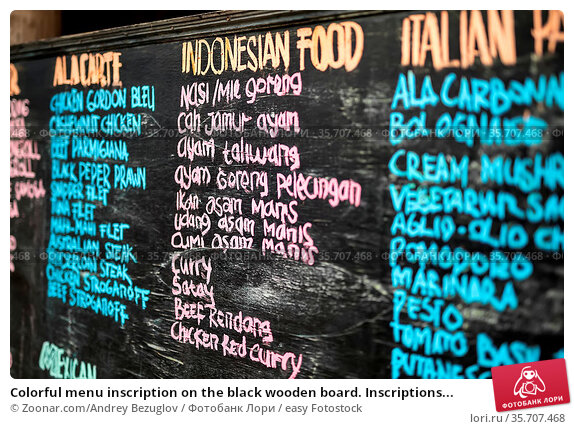 Colorful menu inscription on the black wooden board. Inscriptions... Стоковое фото, фотограф Zoonar.com/Andrey Bezuglov / easy Fotostock / Фотобанк Лори