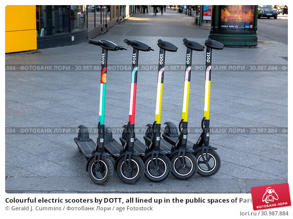 Купить «Colourful electric scooters by DOTT, all lined up in the public spaces of Paris These scooters are the new means of transport voted in by the young generation...», фото № 30987884, снято 26 апреля 2019 г. (c) age Fotostock / Фотобанк Лори