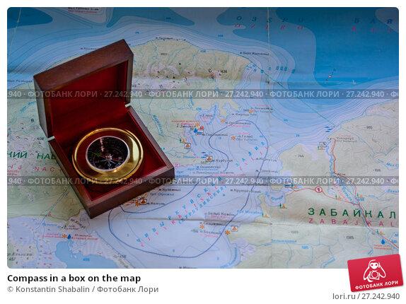Купить «Compass in a box on the map», фото № 27242940, снято 26 ноября 2017 г. (c) Konstantin Shabalin / Фотобанк Лори