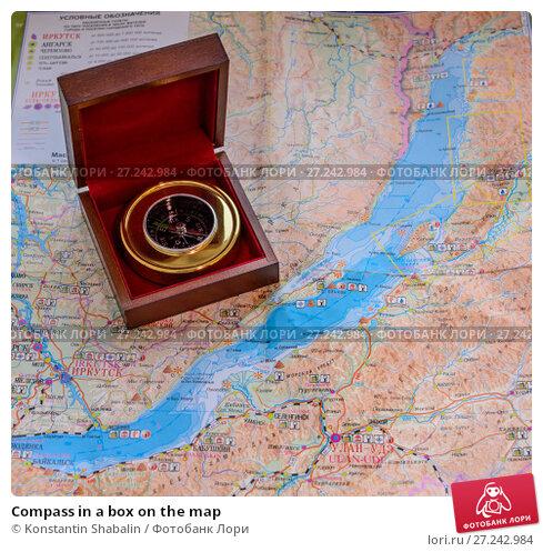 Купить «Compass in a box on the map», фото № 27242984, снято 26 ноября 2017 г. (c) Konstantin Shabalin / Фотобанк Лори