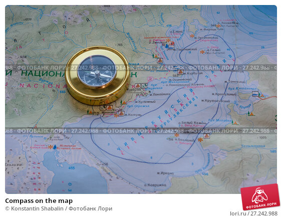 Купить «Compass on the map», фото № 27242988, снято 26 ноября 2017 г. (c) Konstantin Shabalin / Фотобанк Лори