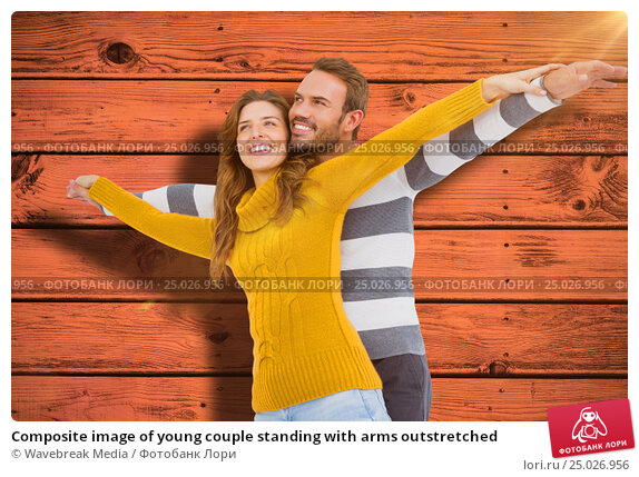 Купить «Composite image of young couple standing with arms outstretched», фото № 25026956, снято 20 февраля 2019 г. (c) Wavebreak Media / Фотобанк Лори