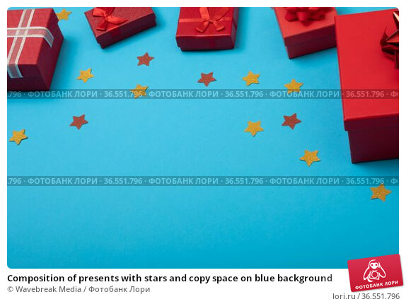 Composition of presents with stars and copy space on blue background. Стоковое фото, агентство Wavebreak Media / Фотобанк Лори