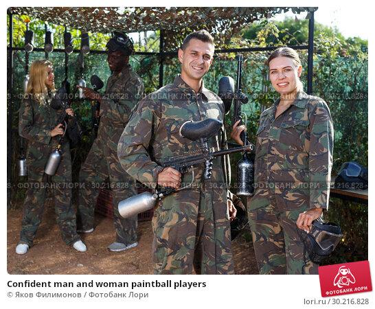Купить «Confident man and woman paintball players», фото № 30216828, снято 11 августа 2018 г. (c) Яков Филимонов / Фотобанк Лори