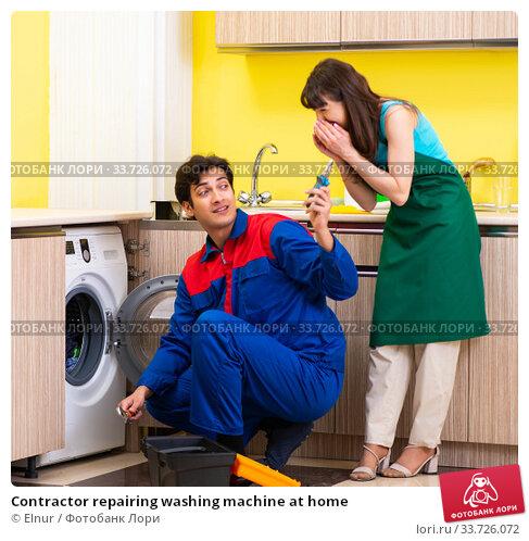 Купить «Contractor repairing washing machine at home», фото № 33726072, снято 20 июня 2018 г. (c) Elnur / Фотобанк Лори
