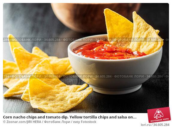 Corn nacho chips and tomato dip. Yellow tortilla chips and salsa on... Стоковое фото, фотограф Zoonar.com/JIRI HERA / easy Fotostock / Фотобанк Лори