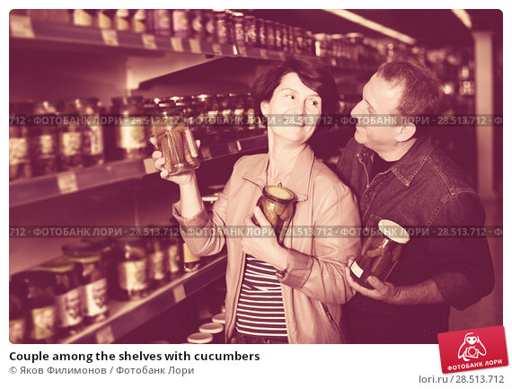 Купить «Couple among the shelves with cucumbers», фото № 28513712, снято 19 июля 2019 г. (c) Яков Филимонов / Фотобанк Лори