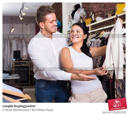 Купить «couple buying jacket», фото № 29633332, снято 24 октября 2016 г. (c) Яков Филимонов / Фотобанк Лори