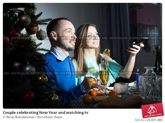 Couple celebrating New Year and watching tv. Стоковое фото, фотограф Яков Филимонов / Фотобанк Лори