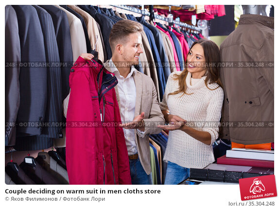 Couple deciding on warm suit in men cloths store. Стоковое фото, фотограф Яков Филимонов / Фотобанк Лори