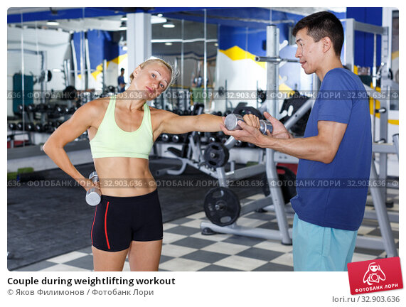 Couple during weightlifting workout. Стоковое фото, фотограф Яков Филимонов / Фотобанк Лори