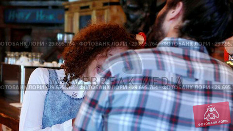 Купить «Couple interacting with each other at bar counter», видеоролик № 29695764, снято 14 ноября 2016 г. (c) Wavebreak Media / Фотобанк Лори