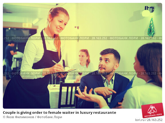 Купить «Couple is giving order to female waiter in luxury restaurante», фото № 28163252, снято 18 декабря 2017 г. (c) Яков Филимонов / Фотобанк Лори
