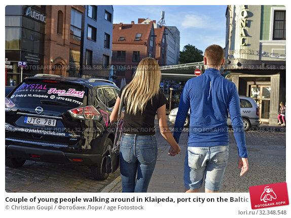 Купить «Couple of young people walking around in Klaipeda, port city on the Baltic Sea, Lithuania, Europe.», фото № 32348548, снято 23 июня 2019 г. (c) age Fotostock / Фотобанк Лори