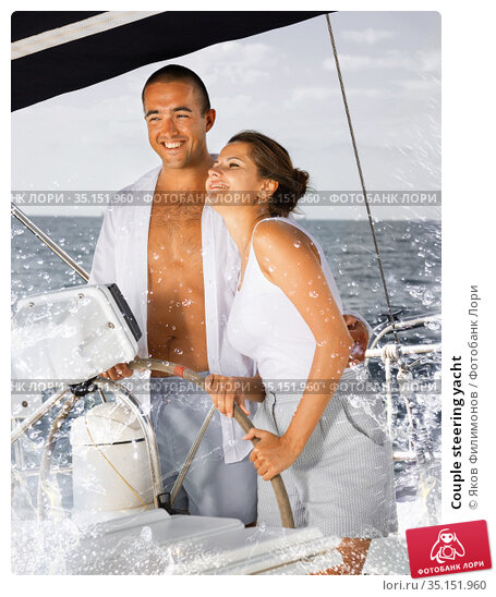 Couple steering yacht. Стоковое фото, фотограф Яков Филимонов / Фотобанк Лори