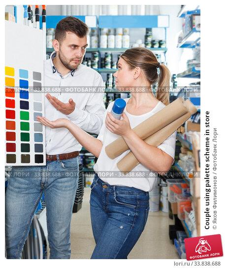 Купить «Couple using palette scheme in store», фото № 33838688, снято 17 мая 2018 г. (c) Яков Филимонов / Фотобанк Лори