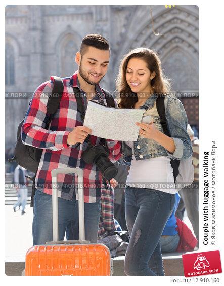 Купить «Couple with luggage walking», фото № 12910160, снято 21 февраля 2019 г. (c) Яков Филимонов / Фотобанк Лори