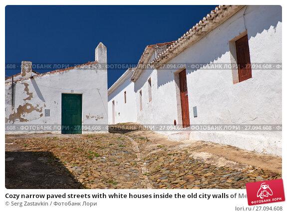 Купить «Cozy narrow paved streets with white houses inside the old city walls of Mertola. Beja. Portugal», фото № 27094608, снято 30 июня 2016 г. (c) Serg Zastavkin / Фотобанк Лори