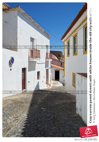 Купить «Cozy narrow paved streets with white houses inside the old city walls of Mertola. Beja. Portugal», фото № 28238056, снято 30 июня 2016 г. (c) Serg Zastavkin / Фотобанк Лори