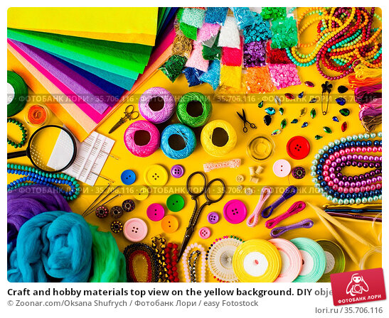 Craft and hobby materials top view on the yellow background. DIY objects... Стоковое фото, фотограф Zoonar.com/Oksana Shufrych / easy Fotostock / Фотобанк Лори