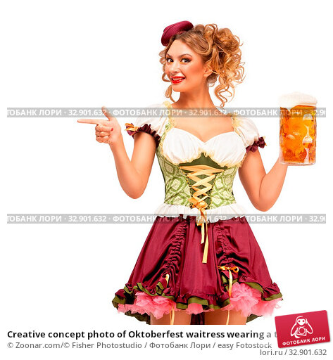 Creative concept photo of Oktoberfest waitress wearing a traditional Bavarian costume with beer isolated on white background. Стоковое фото, фотограф Zoonar.com/© Fisher Photostudio / easy Fotostock / Фотобанк Лори