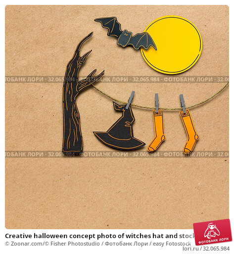 Creative halloween concept photo of witches hat and stockings made of paper on brown background. Стоковое фото, фотограф Zoonar.com/© Fisher Photostudio / easy Fotostock / Фотобанк Лори
