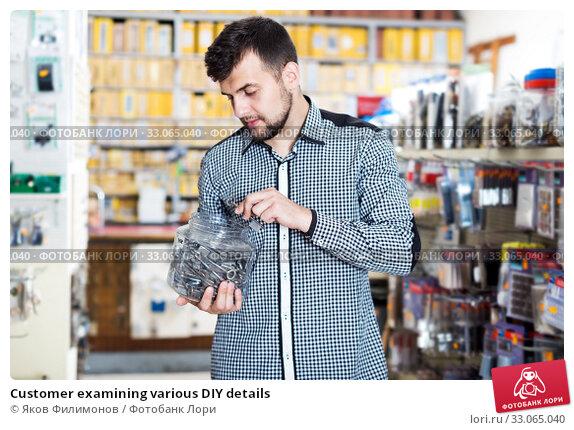 Customer examining various DIY details. Стоковое фото, фотограф Яков Филимонов / Фотобанк Лори