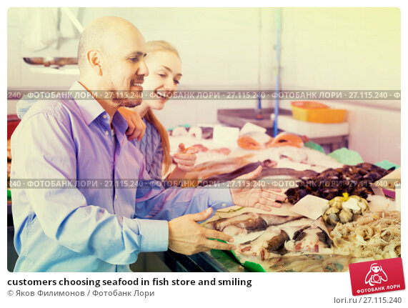 Купить «customers choosing seafood in fish store and smiling», фото № 27115240, снято 20 ноября 2017 г. (c) Яков Филимонов / Фотобанк Лори