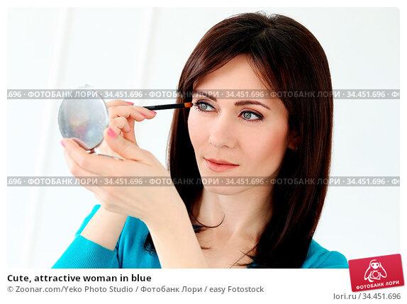 Cute, attractive woman in blue. Стоковое фото, фотограф Zoonar.com/Yeko Photo Studio / easy Fotostock / Фотобанк Лори