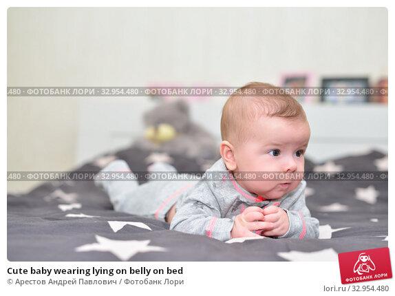 Cute baby wearing lying on belly on bed. Стоковое фото, фотограф Арестов Андрей Павлович / Фотобанк Лори