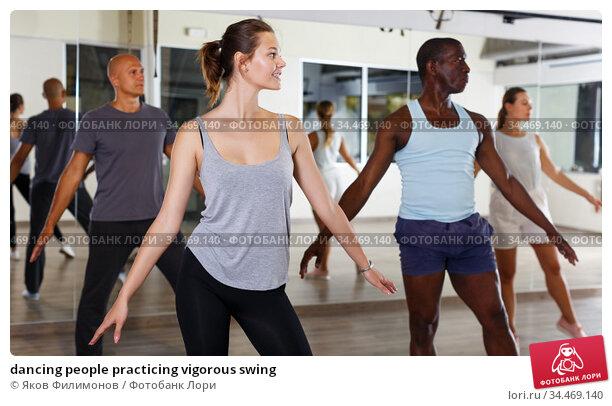 dancing people practicing vigorous swing. Стоковое фото, фотограф Яков Филимонов / Фотобанк Лори