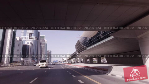 Купить «Day traffic in the business center of Dubai stock footage video», видеоролик № 28797224, снято 8 апреля 2018 г. (c) Юлия Машкова / Фотобанк Лори