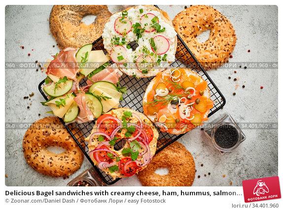 Delicious Bagel sandwiches with creamy cheese, ham, hummus, salmon... Стоковое фото, фотограф Zoonar.com/Daniel Dash / easy Fotostock / Фотобанк Лори