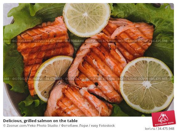 Delicious, grilled salmon on the table. Стоковое фото, фотограф Zoonar.com/Yeko Photo Studio / easy Fotostock / Фотобанк Лори