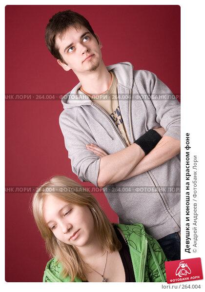 Девушка и юноша на красном фоне, фото № 264004, снято 26 апреля 2008 г. (c) Андрей Андреев / Фотобанк Лори