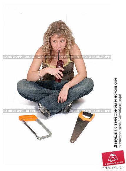Купить «Девушка с телефоном и ножовкой», фото № 30120, снято 31 марта 2007 г. (c) Vdovina Elena / Фотобанк Лори