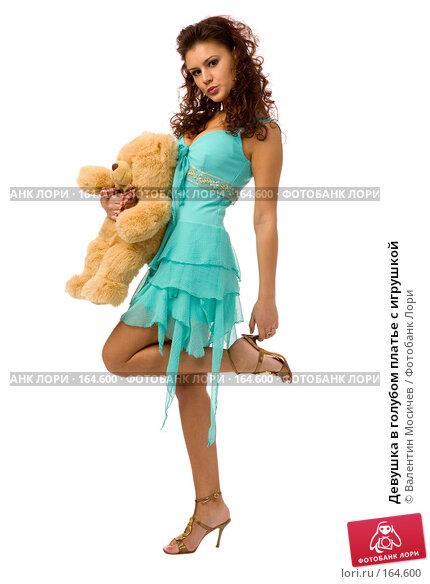 Купить «Девушка в голубом платье с игрушкой», фото № 164600, снято 23 декабря 2007 г. (c) Валентин Мосичев / Фотобанк Лори