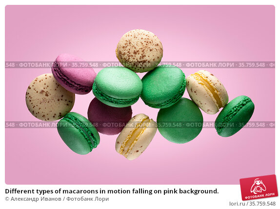 Different types of macaroons in motion falling on pink background. Стоковое фото, фотограф Александр Иванов / Фотобанк Лори