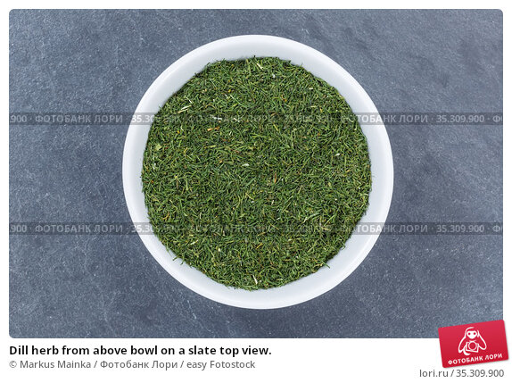 Dill herb from above bowl on a slate top view. Стоковое фото, фотограф Markus Mainka / easy Fotostock / Фотобанк Лори