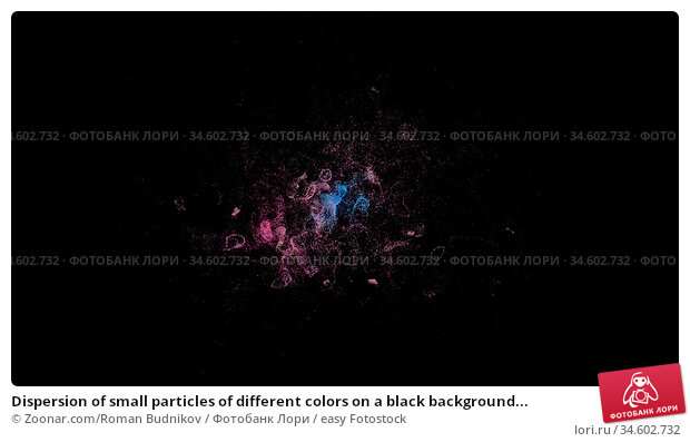 Dispersion of small particles of different colors on a black background... Стоковое фото, фотограф Zoonar.com/Roman Budnikov / easy Fotostock / Фотобанк Лори