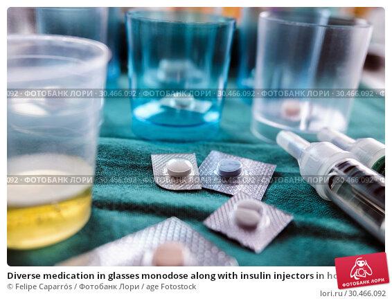 Diverse medication in glasses monodose along with insulin injectors in hospital, conceptual image, horizontal composition. Стоковое фото, фотограф Felipe Caparrós / age Fotostock / Фотобанк Лори