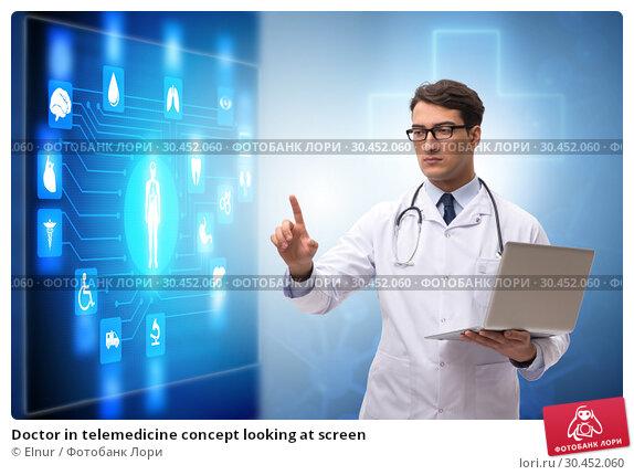 Doctor in telemedicine concept looking at screen. Стоковое фото, фотограф Elnur / Фотобанк Лори