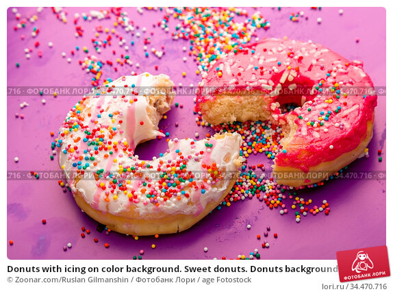 Donuts with icing on color background. Sweet donuts. Donuts background... Стоковое фото, фотограф Zoonar.com/Ruslan Gilmanshin / age Fotostock / Фотобанк Лори