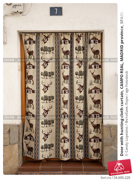 Door with hunting cloth curtain, CAMPO REAL, MADRID province, SPAIN... Стоковое фото, фотограф Candy Lopesino / age Fotostock / Фотобанк Лори