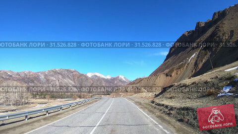 Купить «Driving along mountain asphalt road Chuysky Tract along Kurai Ridge on Altai betveen Kosh-Agach and Kurai intermountain hollows», видеоролик № 31526828, снято 6 июня 2019 г. (c) Serg Zastavkin / Фотобанк Лори